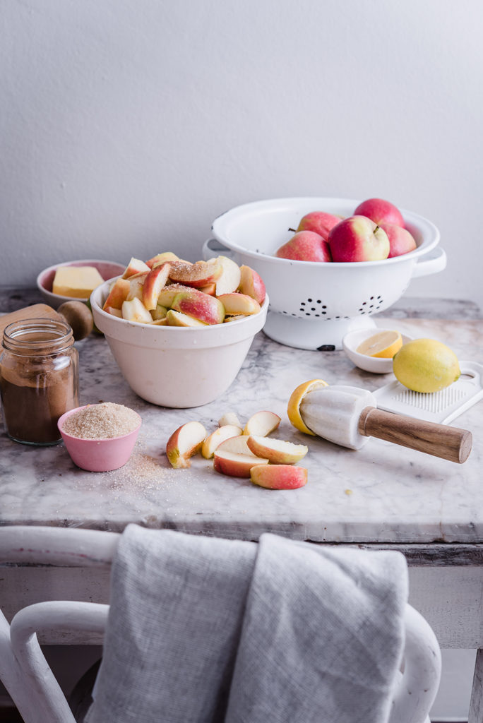 ingredients for apple pie on marble table